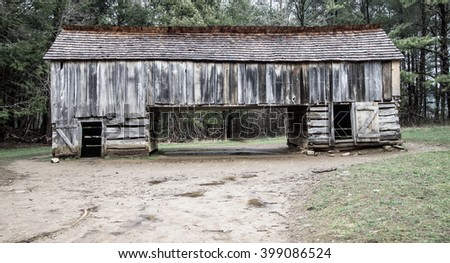 Pioneer Barn In Cades Cove. 18th century pioneer barn in the Cades Cove area of the Great Smoky Mountains National Park. This is a public display in a national park and not private property. - stock photo