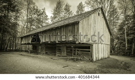 Pioneer Barn. 18th century pioneer barn in the Cades Cove area of the Great Smoky Mountains National Park. Gatlinburg, Tennessee. This is a public display in a national park and not private property. - stock photo