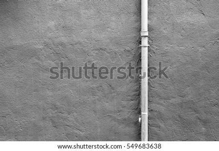 Pipe cement wall, detail of a wall painted with a metal pipe, outdoor exploration