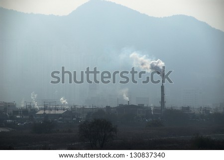Pipe factory smoke emission - stock photo