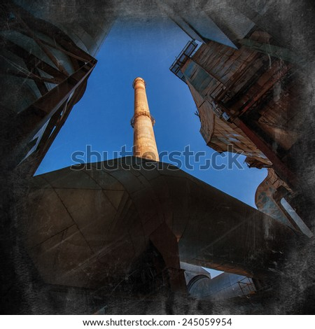 pipe for exhaust emissions on a sky background - stock photo