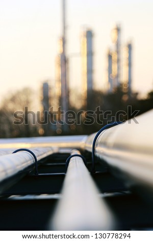 pipe going to the refinery station - stock photo