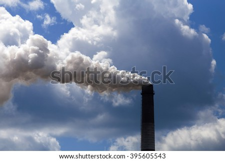 Pipe heavy industry factory emits into the air precipitation, smog and gas, polluting the planet