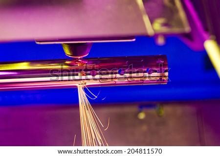 Pipe laser cutting machine at work - stock photo