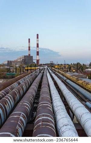 Pipe leading to the thermal power plant in the background perspective - stock photo