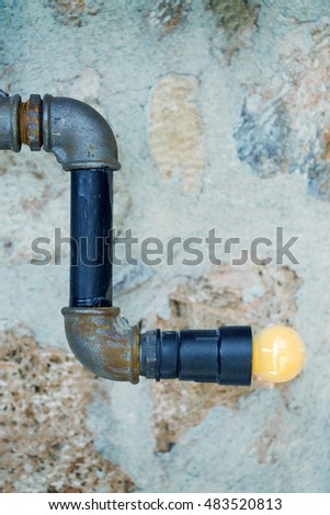 Pipe on the background of a stone wall. Toned