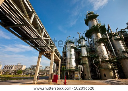 pipe rack in petrochemical plant - stock photo