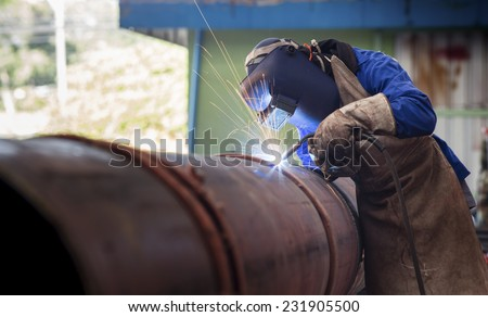 Pipe welding on the pipeline construction - stock photo