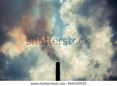 pipe with thick smoke and the sky on contrasting background of clouds, filter