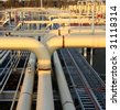 Pipe work of a natural gas plant - stock photo