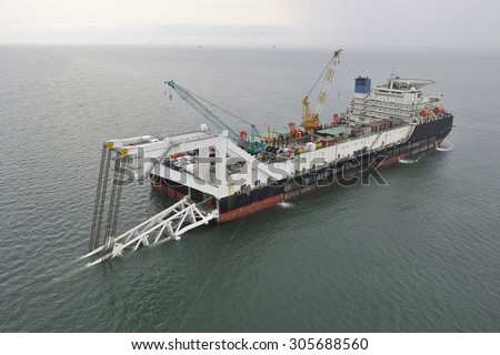Pipelaying barge. Top view. - stock photo
