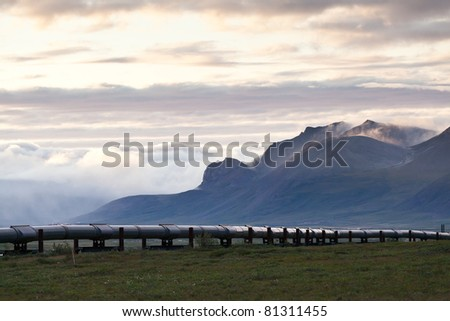 Pipeline along side Dalton highway with mountain as a background