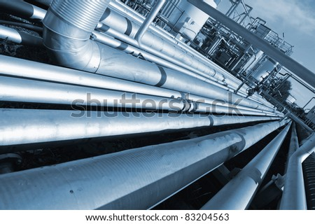 pipeline construction leading to refinery, blue toning concept - stock photo