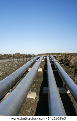pipelines in a lava landscape