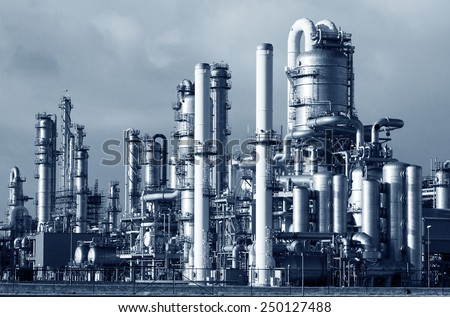 Pipelines of a oil and gas refinery industrial plant. - stock photo