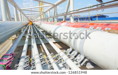 pipelines onto structure. - stock photo