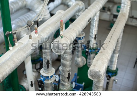 Pipes in a boiler room. Isolation of pipes. Water heating. Power supply. Water supply. - stock photo