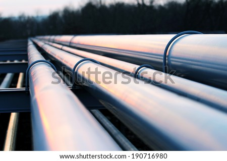 pipes in crude oil factory - stock photo
