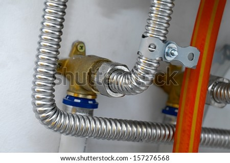 Pipes of a heating system - stock photo