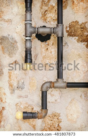 Pipes on the background of a stone wall