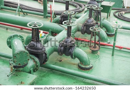 Pipes on the deck of the ship - stock photo