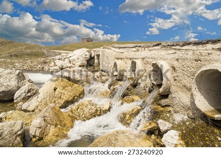 pipes water flow, nature spring, in Aoos springs Ioannina Greece - stock photo