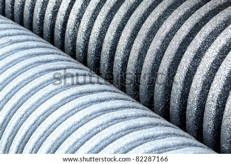 Pipes with stripes form background pattern