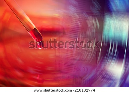 Pipette with liquid biological material. Laboratory concept. - stock photo