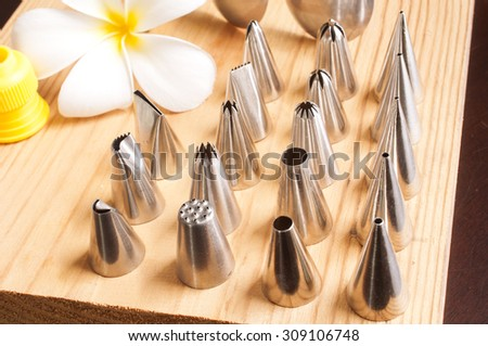 piping tips  for decoration of cake - stock photo