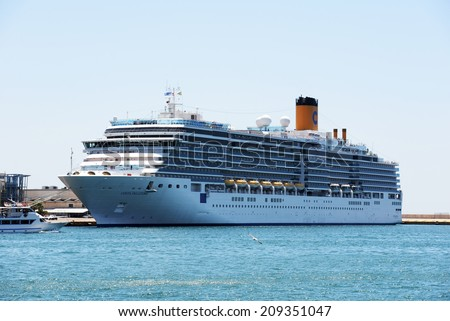 Piraeus, Greece - August 26, 2013.:Costa Delizioca is a cruise ship by Costa Crociere. Built in 2010,Tonnage 92,700 GT, Length 294 m, Decks 16,Passengers 2,828 and Crew 1,100.