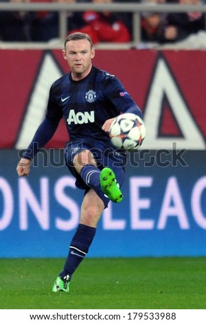 PIRAEUS, GREECE -FEB. 25. Wayne Rooney of Manchester United during the Champions League football  match between Olympiacos FC and Manchester United (2-0) at Karaiskakis Stadium on February 25, 2014  - stock photo