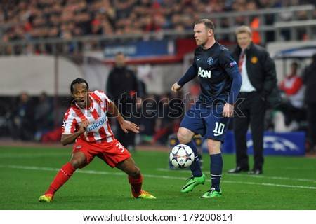 PIRAEUS, GREECE -FEB. 25. Wayne Rooney of Manchester United (R) and Leandro Salino (L) during the match between Olympiacos FC and Manchester United (2-0) at Karaiskakis Stadium on February 25, 2014  - stock photo