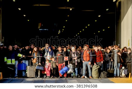 Piraeus, Greece - February 23, 2016: Migrants and refugees arrive at the port of Piraeus. Syrians and Iraqis to continue their journey towards the borders after their arrival to the port