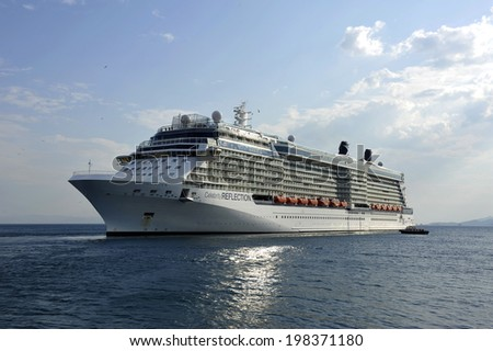 PIRAEUS, GREECE -June 11, 2014. Celebrity Reflection is a cruise ship owned and operated by Celebrity Cruises. Ship was built in 2012 with length 319 m and has capacity of 3046 passengers. - stock photo