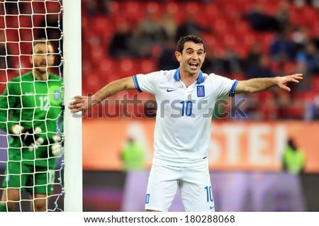 PIRAEUS GREECE MAR 05 Greece's Giorgos Karagounis, during a friendly match against South Korea (0-2 ) at Karaiskakis stadium in Piraeus port, near Athens, Wednesday, March 5, 2014 - stock photo