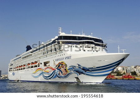PIRAEUS, GREECE -MAY 27, 2014. Norwegian Spirit is a cruise ship operated by Norwegian Cruise Line. departs from Piraeus. Ship was built in 1998 and has a capacity of 1996 passengers and 965 crew. - stock photo