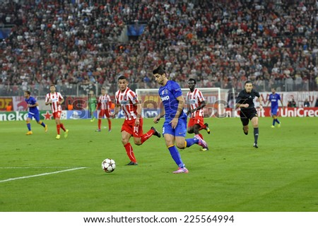 Piraeus, Greece Oct. 22, 2014.Juventus Alvaro Morata, with the ball, next to Elabdellaoui (14) during t the Champions League football match between Olympiakos vs Juventus (1-0) at Karaiskaki Stadium. - stock photo