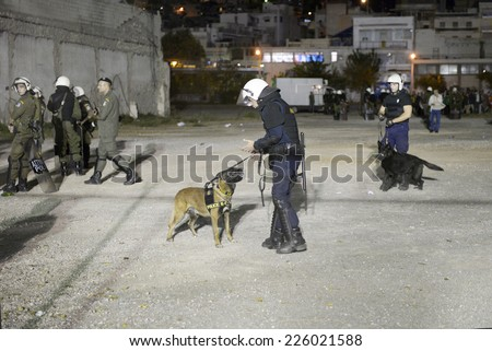 Piraeus, Greece Oct. 22, 2014. Security measures with police dogs outside the Karaiskakis Stadium before the champions league mach Olympiacos vs Juventus. - stock photo