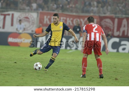 Piraeus,Greece Sept 16, 2014. Atletico's Koke with the ball during the Champions League soccer match against Olympiacos at Georgios Karaiskakis Stadium in the port of Piraeus near Athens. - stock photo