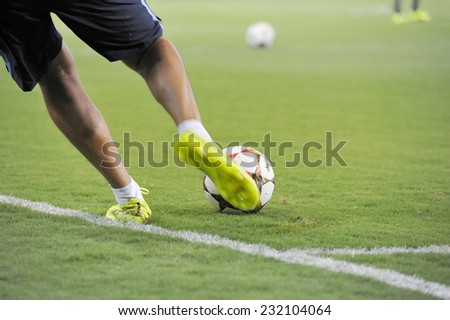 Piraeus,Greece Sept 16, 2014. Kicking the official soccer ball of the Champions League 2014 in the Karaiskakis stadium field before the match between Olympiakos and Atletico Madrid (3-2)