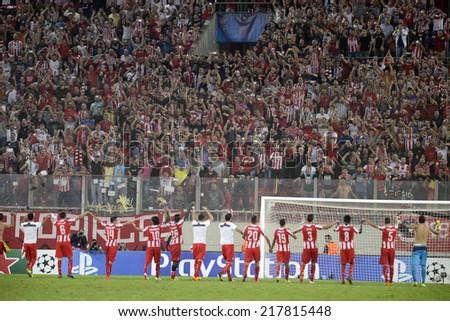 Piraeus,Greece Sept 16, 2014. Olympiacos players wave to their fans after the Champions League  soccer match against Atletico Madrid. Olympiacos won 3-2.  - stock photo