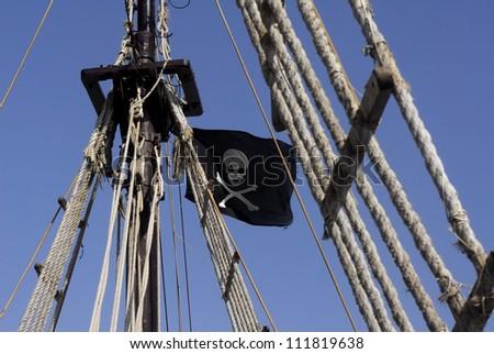 Pirata flag on pirate ship - stock photo