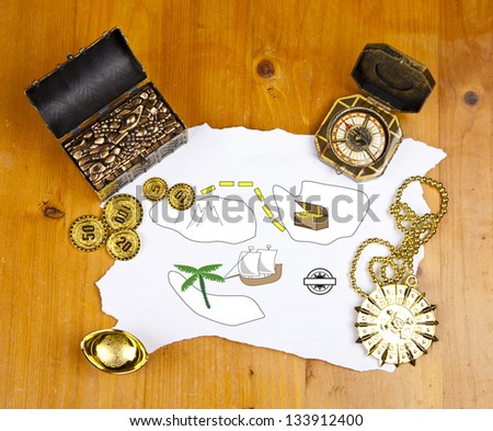Pirate blank map with treasure, coins, medal, ring and map - stock photo