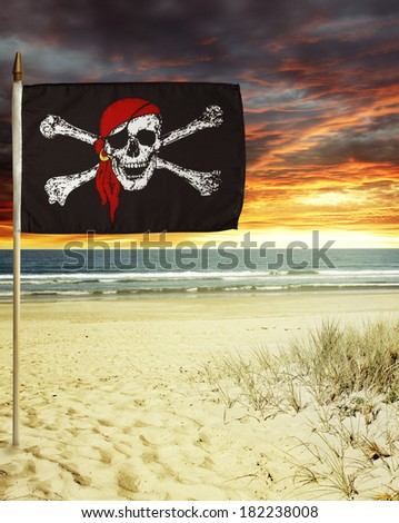 Pirate flag in sand  - stock photo