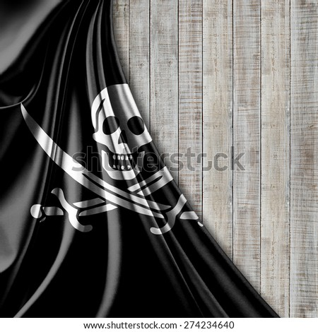 Pirate flag of fabric texture and wood background - stock photo