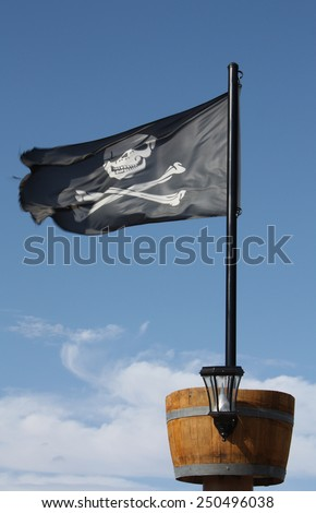 Pirate Flag Skull and Crossbones black pirate flag with crows nest. - stock photo
