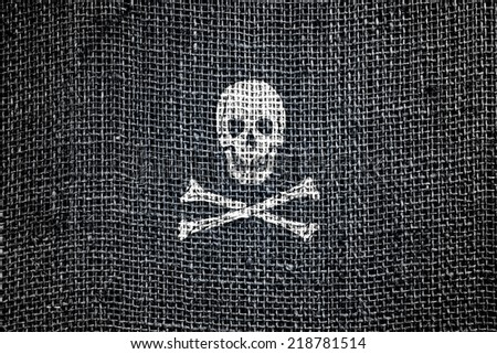 Pirate flag. Textile texture.  - stock photo