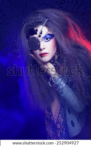 Pirate. One-eyed young woman with artistic visage posing in smoke