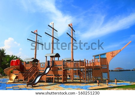 Pirate ship in playground with blue sky - stock photo