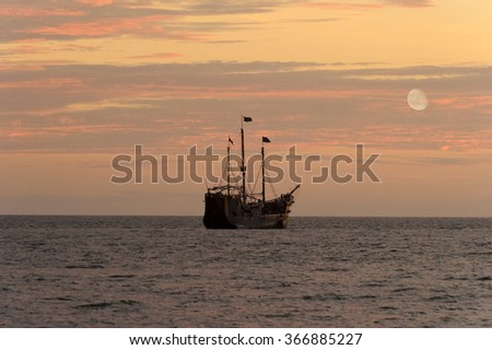 Pirate Ship is a pirate ship out at sea with the moon rising in the sunset sky.